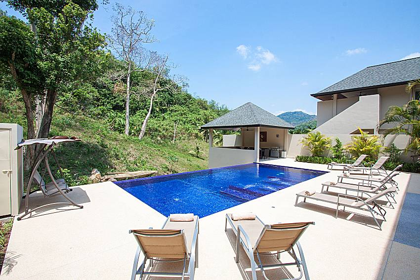 Sun bed near swimming pool Si Mok Villa in Phuket
