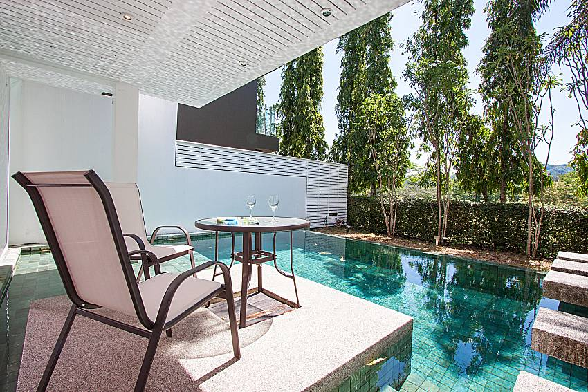Seat near swimming pool Yu-Pha Villa in Phuket