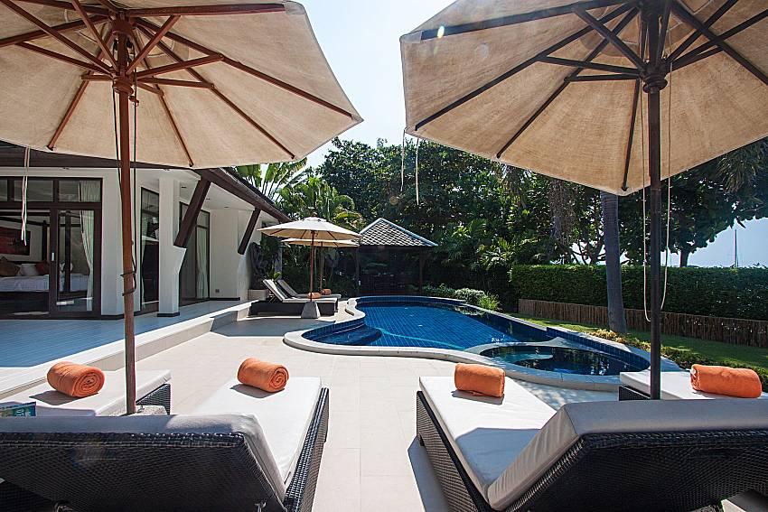 Sun bed near swimming pool and property Blossom Dew Villa B in Samui