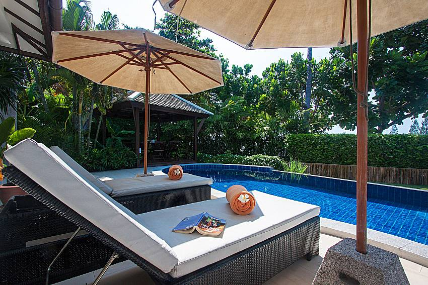 Sun bed near swimming pool and property Blossom Dew Villa B in Samui