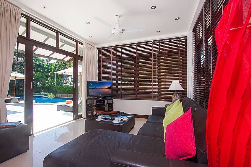 Living room with TV  Blossom Dew Villa B in Samui