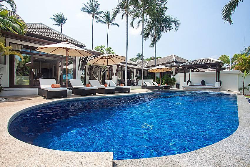 Sun bed near swimming pool and property Blossom Dew Villa C in Samui