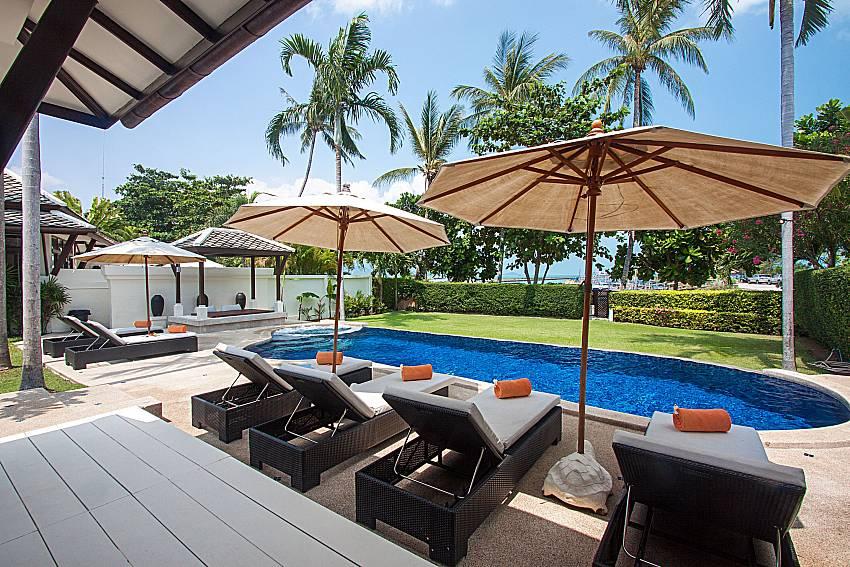 Sun bed near swimming pool with sea view Blossom Dew Villa C in Samui