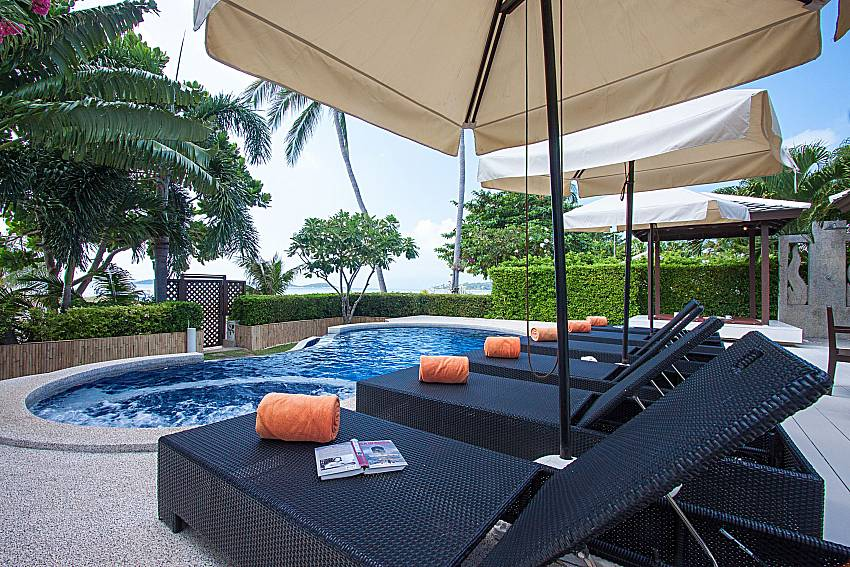Sun bed near swimming pool and sea view Blossom Dew Villa D in Koh Samui