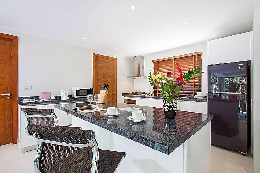 Lounge with kitchen at Triumph Villa in Samui