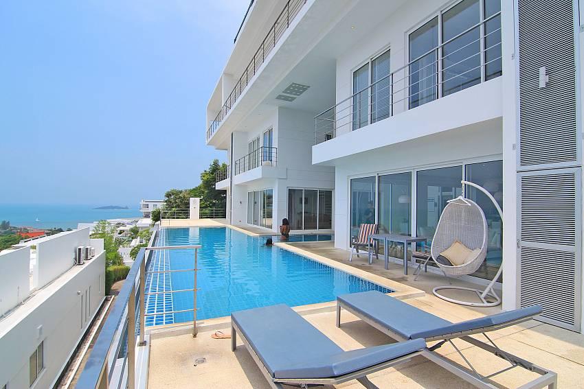 Sun bed near swimming pool with sea view Sirinda Samui Sea View Apartment in Samui