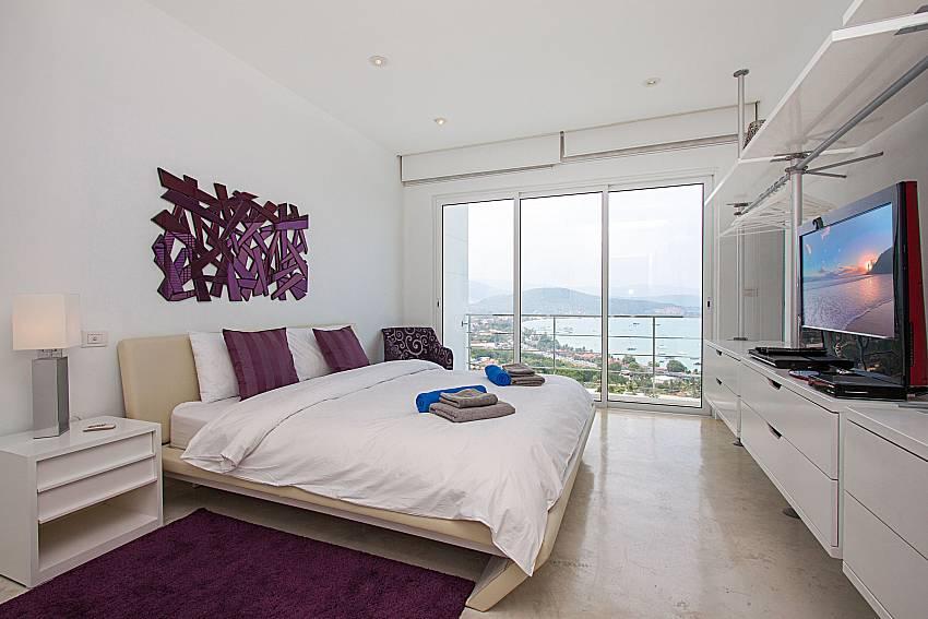 Bedroom with TV Sirinda Samui Sea View Apartment in Samui