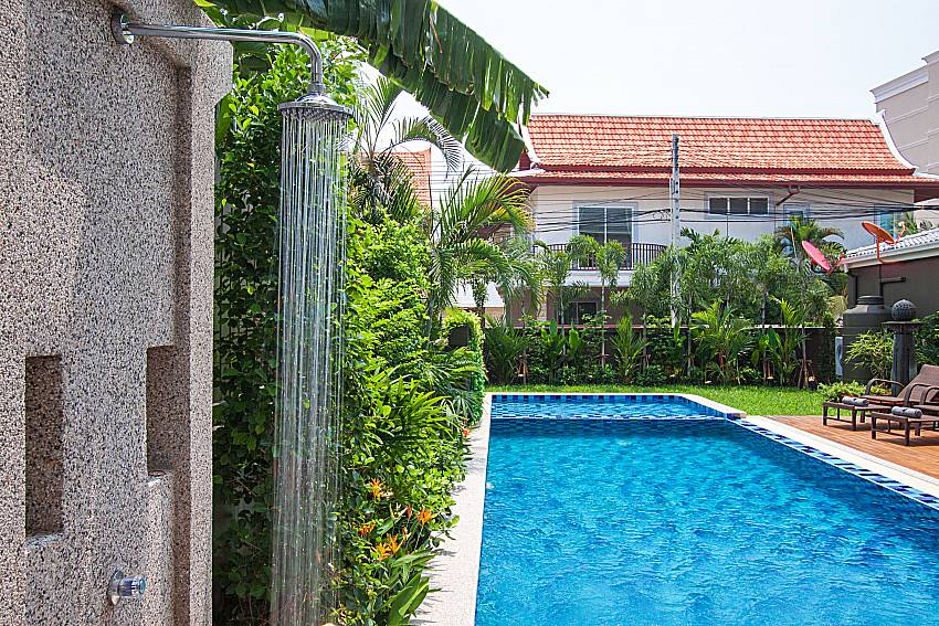 Swimming pool and shower City Haven Villa in Central Pattaya