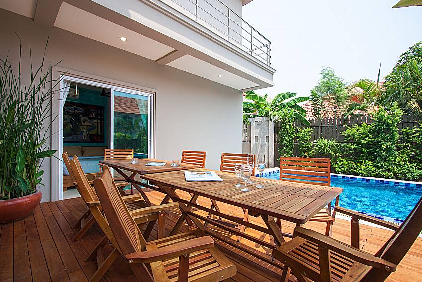 Seat and table near swimming pool City Haven Villa in Central Pattaya