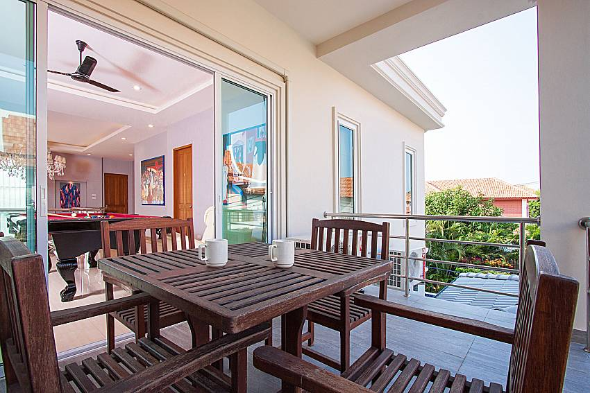 Balcony with seat and table City Haven Villa in Central Pattaya