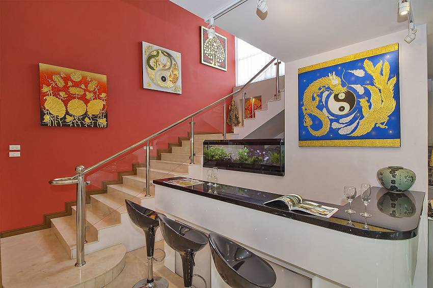 Staircase leading the bedrooms at City Haven Villa in Central Pattaya