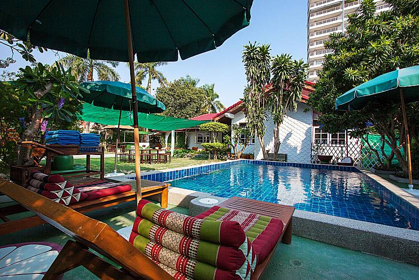 Sun bed near swimming pool Villa Nobility Jomtien Beach in Pattaya