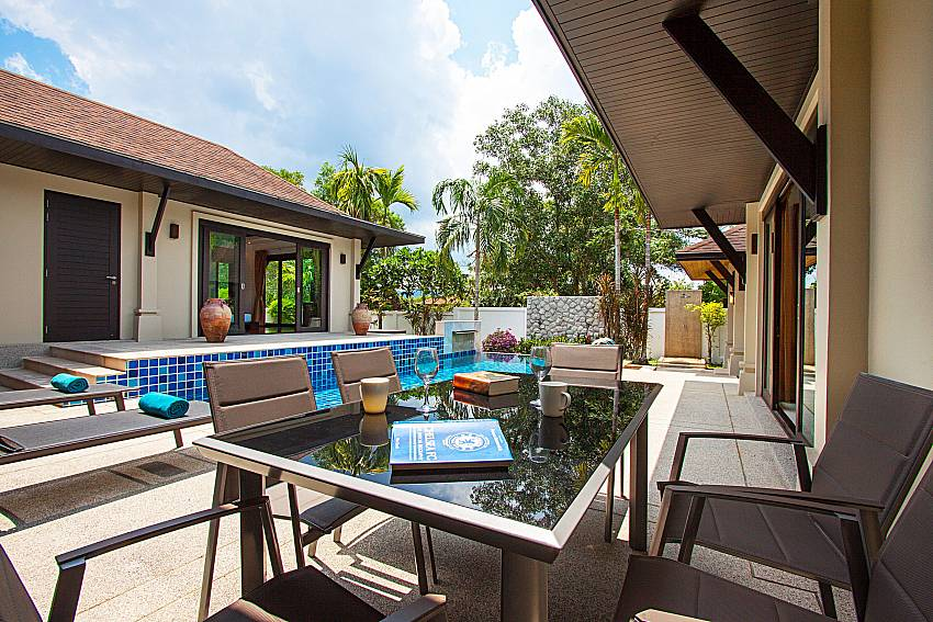 Seat and table near swimming pool Villa Rachana in Phuket