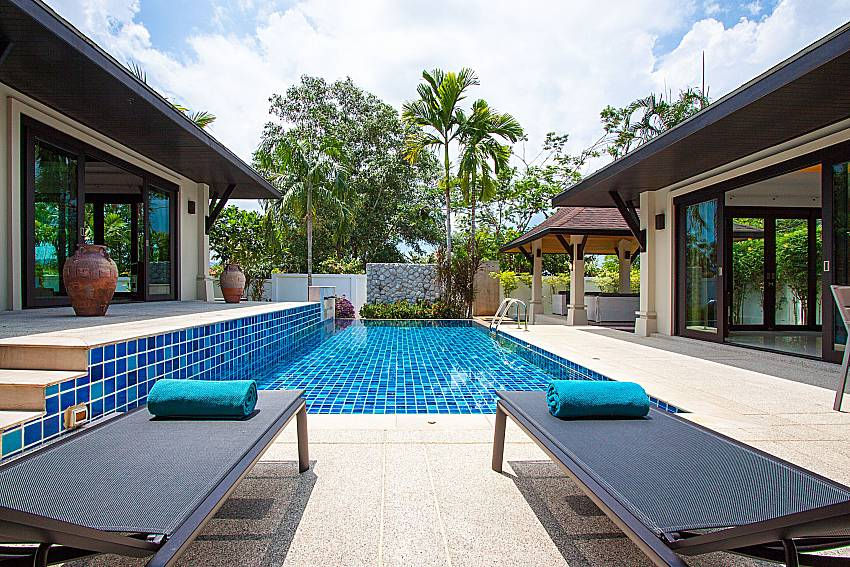 Sun bed near swimming pool Villa Rachana in Phuket