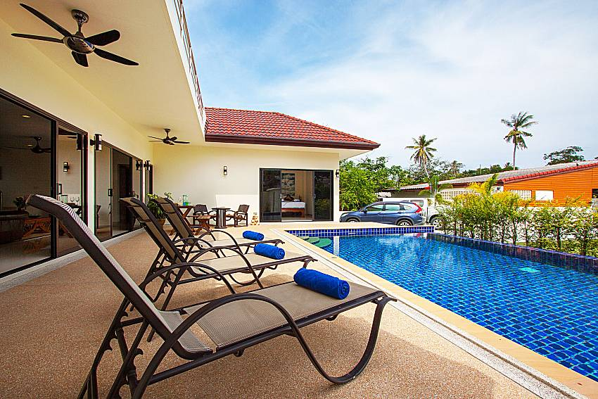 Sun bed near swimming pool Villa Tallandia in Rawai Phuket