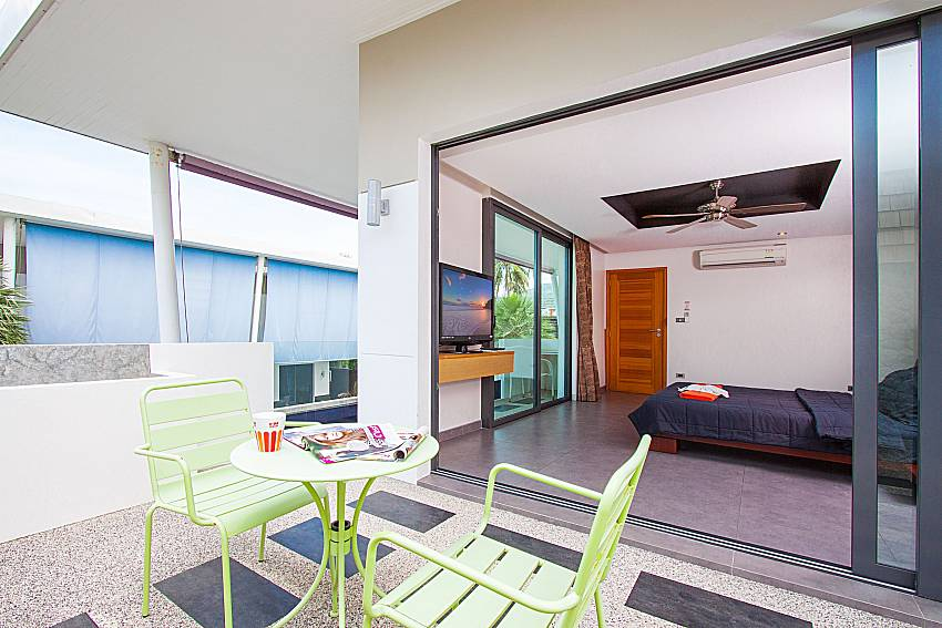 Balcony with seat and table Villa Elina in Phuket