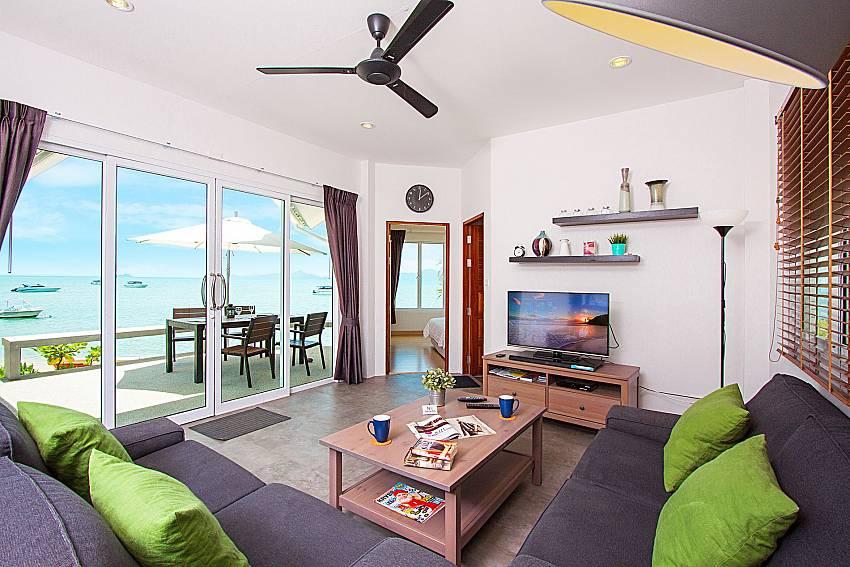 Living room with TV and sea view Interstellar Beachfront Villa B in Samui