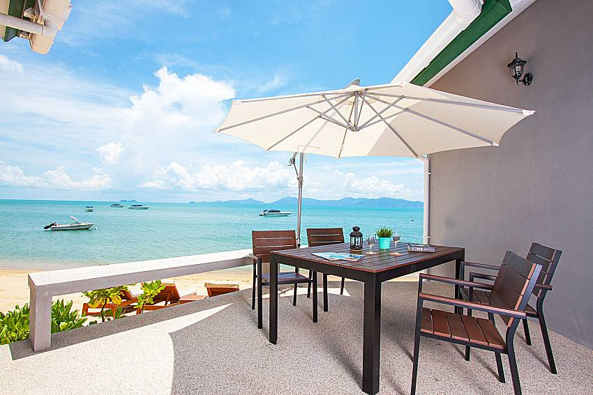 Seat and table with sea view Interstellar Beachfront Villa B in Samui