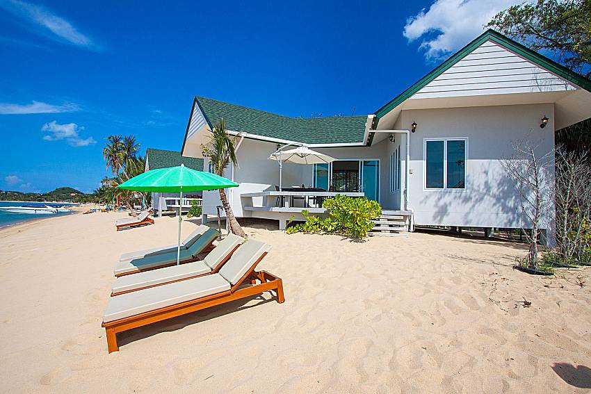 Sun bed on the beach and property Interstellar Beachfront Villa A in Samui