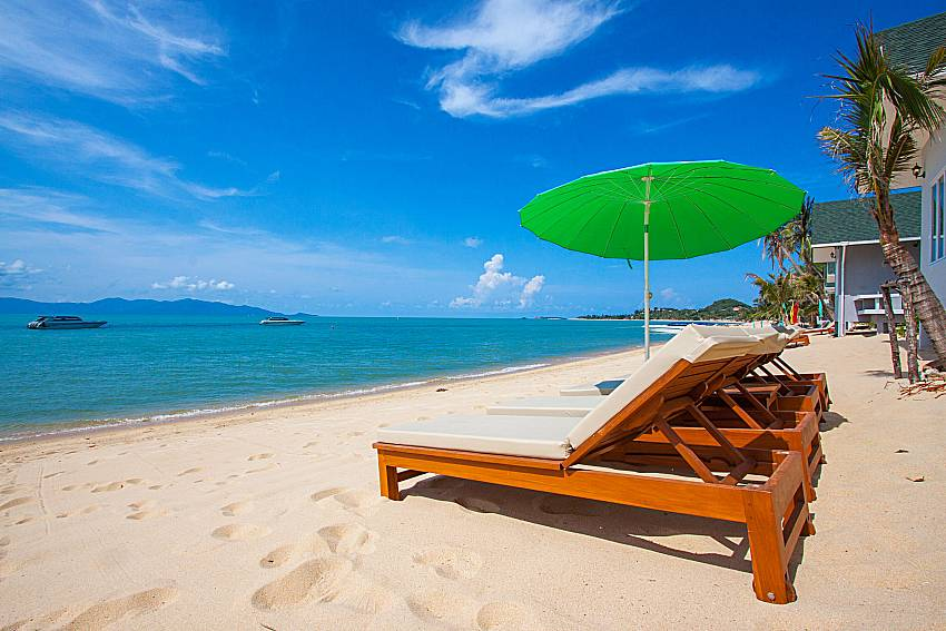 Sun bed on the beach Interstellar Beachfront Villa A in Samui
