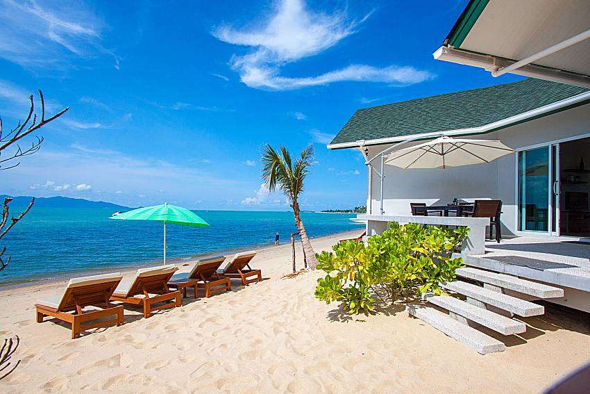 Sun bed on the beach with property Interstellar Beachfront Villa A in Samui