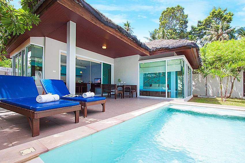 Sun bed near swimming pool and property Moonscape Villa 102 at Chaweng in Samui