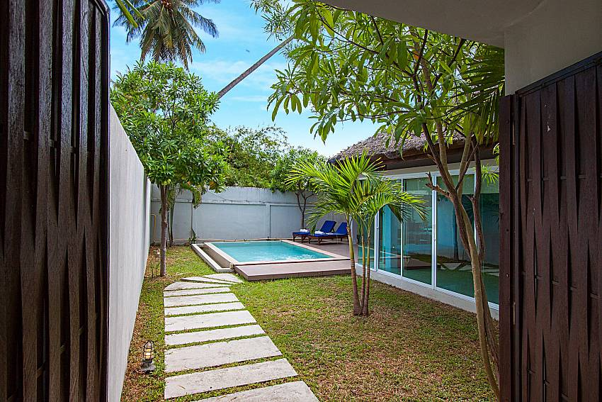 Garden and swimming pool Moonscape Villa 102 at Chaweng in Samui