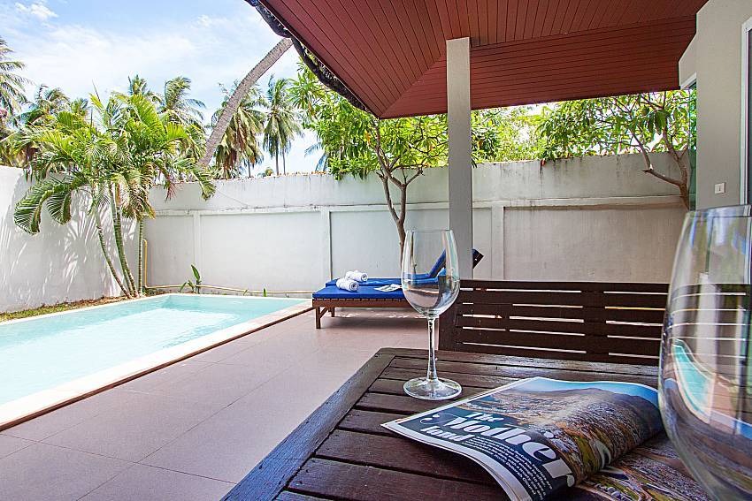 Seat and table near swimming pool Moonscape Villa 102 at Chaweng in Samui