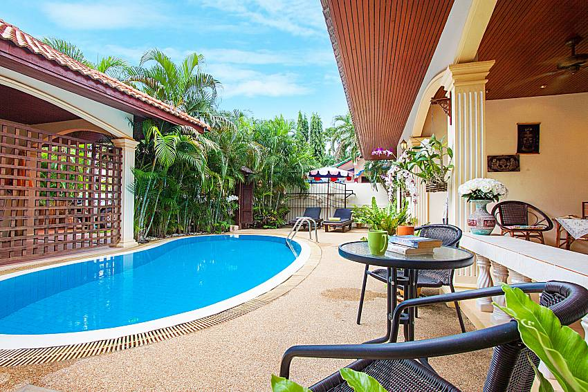Seat and table near swimming pool Villa Kaipo in Phuket