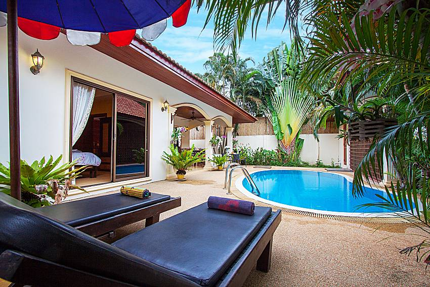 Sun bed near swimming pool and property Villa Kaipo in Phuket