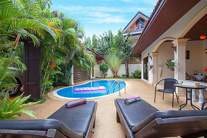 Sun bed near swimming pool and property Genna in Rawai Phuket