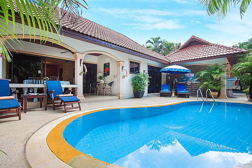 Sun bed near swimming pool and property Villa Onella in Phuket