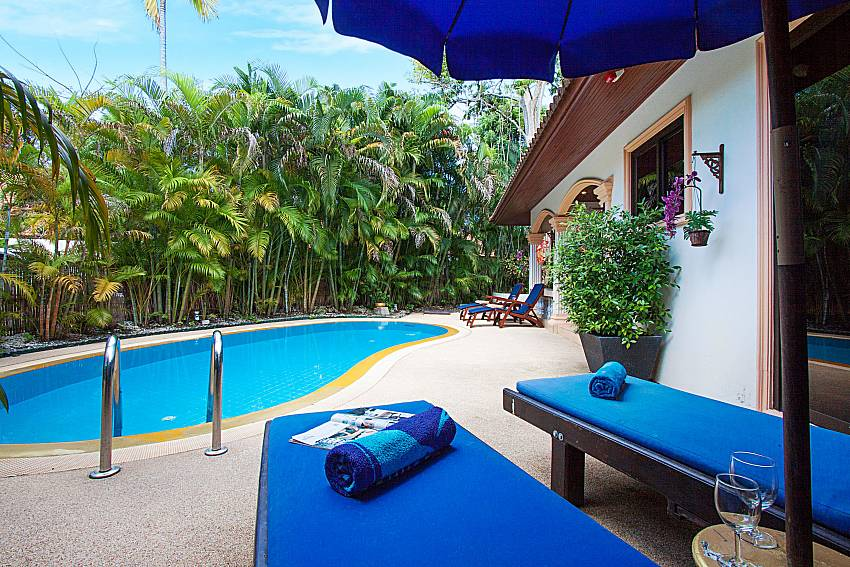 Sun bed near swimming pool Villa Onella in Phuket