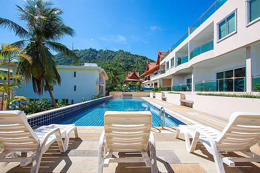 Sun bed near swimming pool and property Vara Apartment at Kata in Phuket
