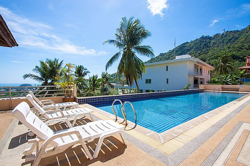 Sun bed near swimming pool and sea view Vara Apartment at Kata in Phuket