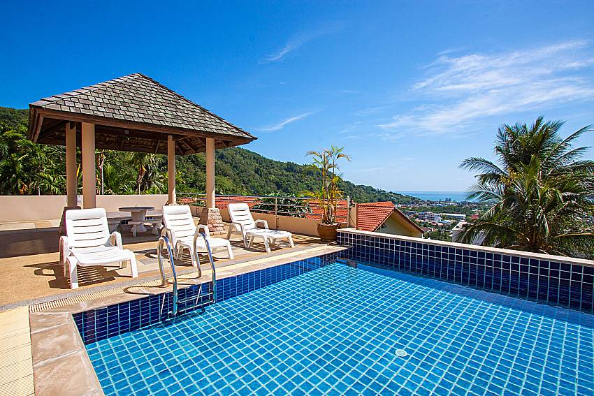 Sun bed and pavilion near swimming pool Vara Apartment at Kata in Phuket
