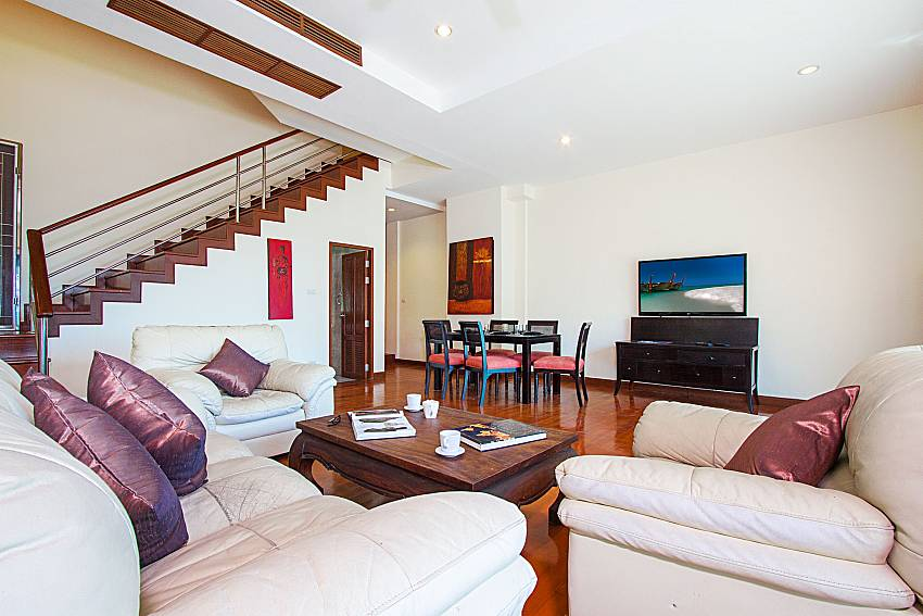 Living room with TV Vara Apartment at Kata in Phuket