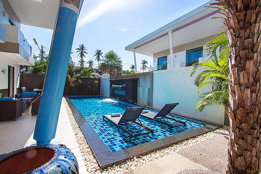 Sun bed near swimming pool Villa Fullan in Phuket