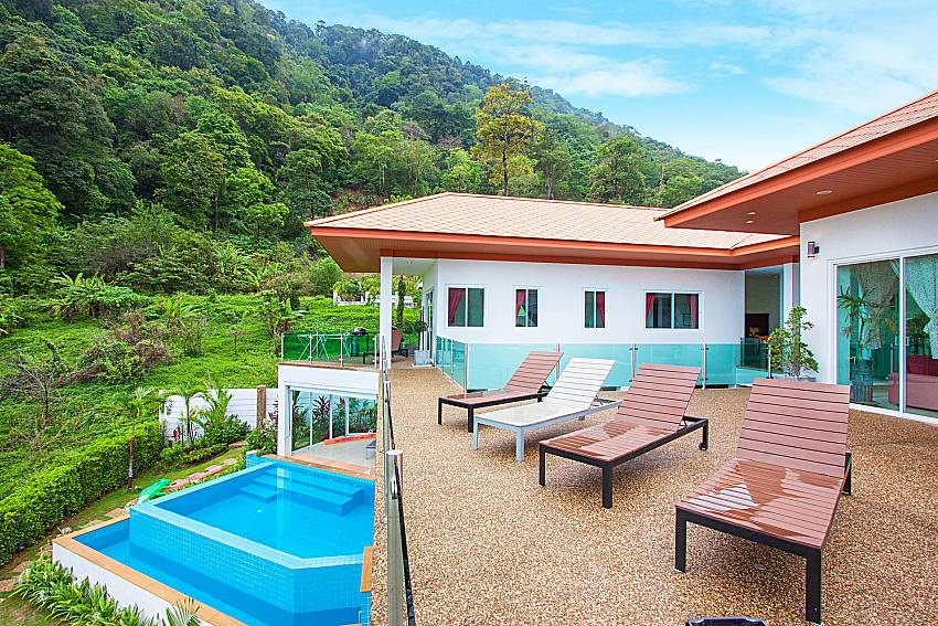 Balcony with sun bed Villa Niyati in Phuket