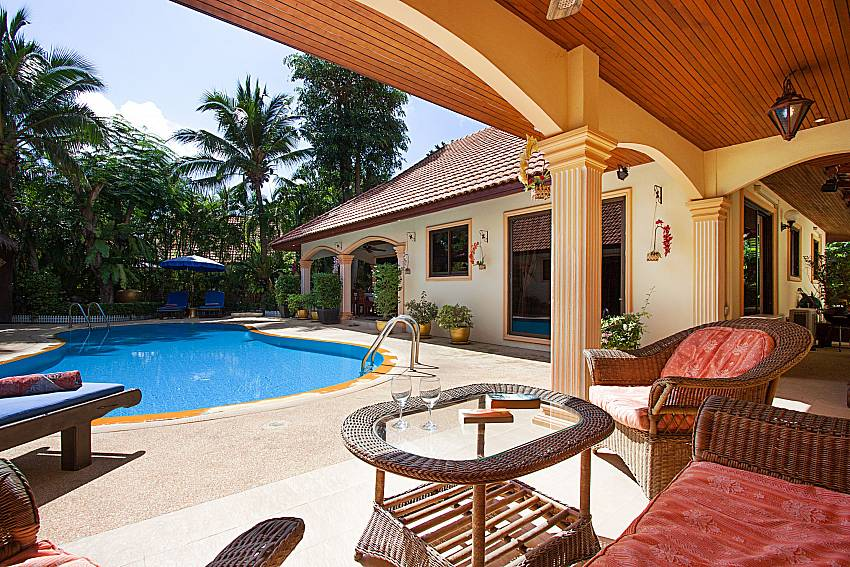 Seat and table near swimming pool Villa Oditi in Phuket