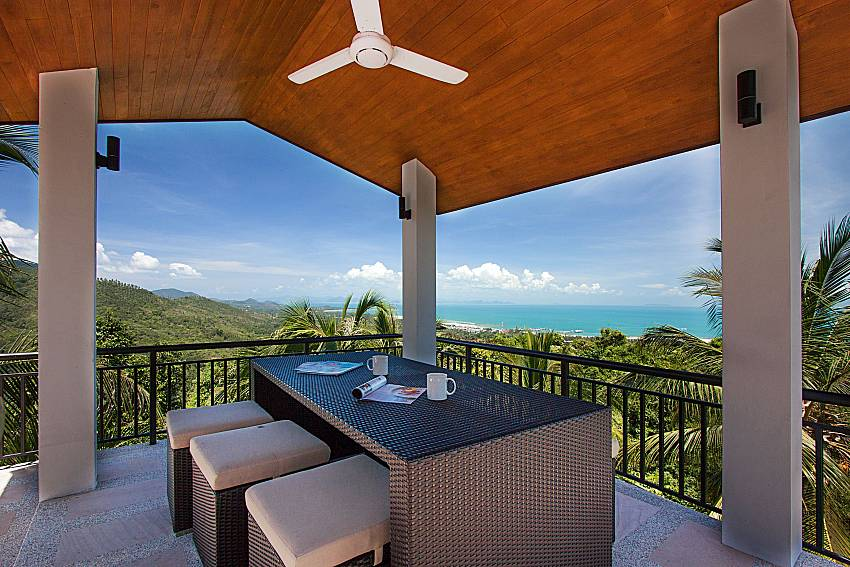 Seat and table with sea view Phukea Villa in Koh Samui