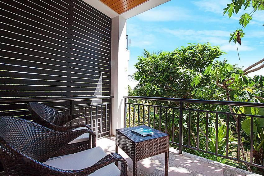Balcony with seat and table Phukea Villa in Koh Samui