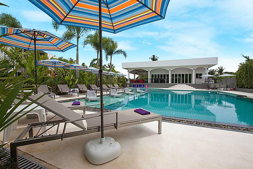 Sun bed near swimming pool Lannister Villa Resort in Bangsaray Pattaya