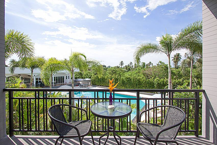 Balcony with seat and table Lannister Villa Resort in Bangsaray Pattaya