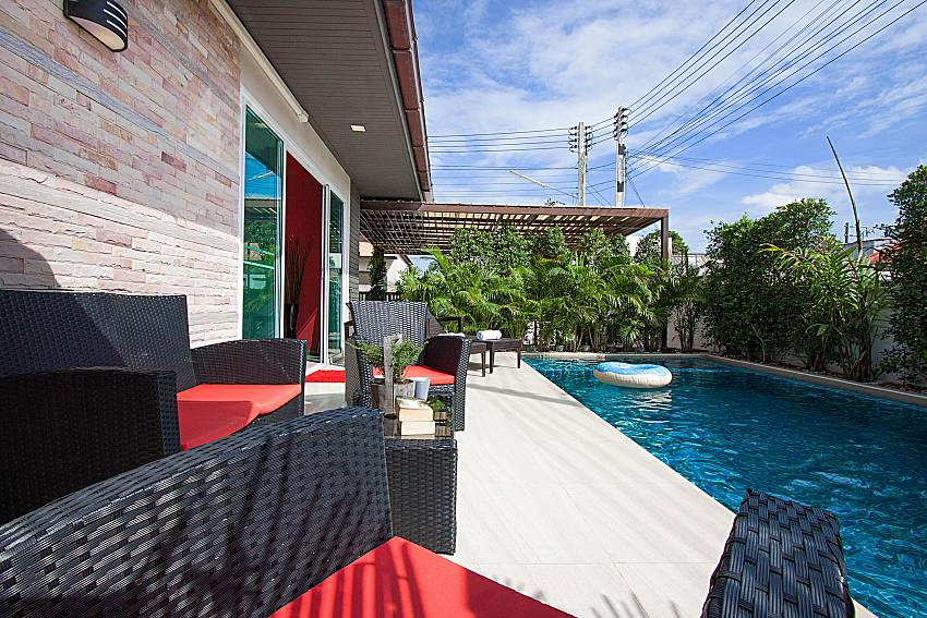 Seat and table near swimming pool Casterly Villa in Jomtien Pattaya