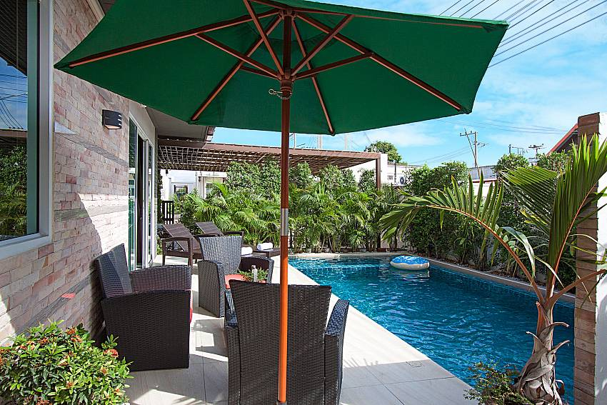Seat near swimming pool Casterly Villa in Jomtien Pattaya
