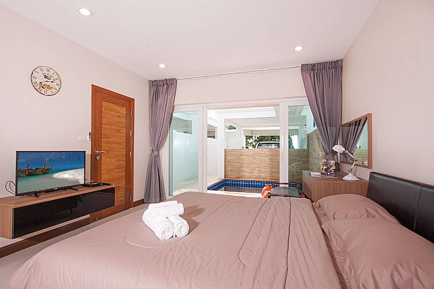 Bedroom with TV Bangsaray Beach House B at Bangsaray Pattaya