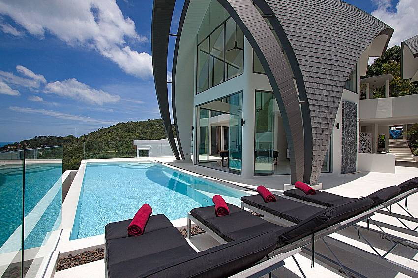 Sun bed near swimming pool and property Sky Dream Villa in Samui