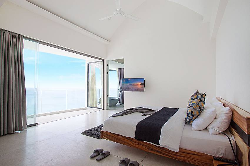 Bedroom with TV and sea view Sky Dream Villa in Samui