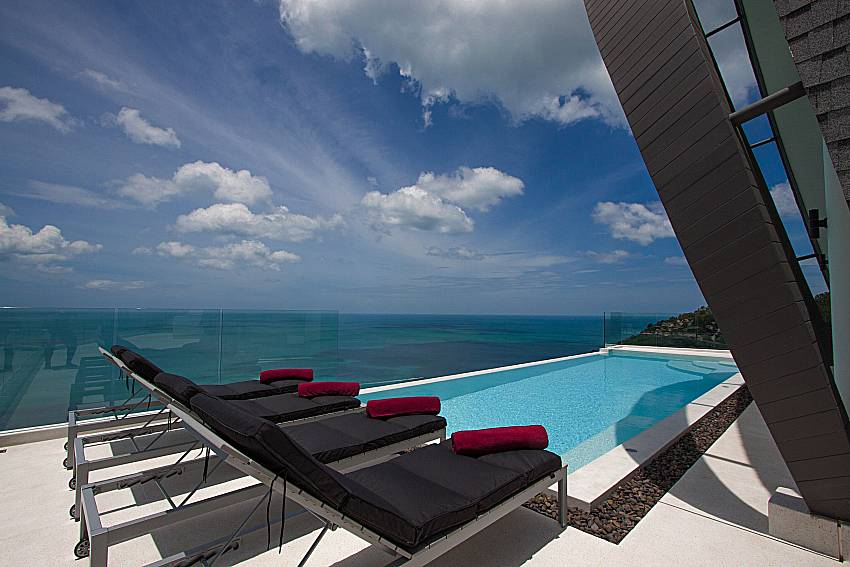 Sun bed near swimming pool and sea view Sky Dream Villa in Samui